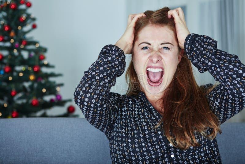 A moça é frustrada sobre o Natal foto de stock royalty free