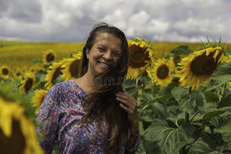 Moça alegre com girassóis fotografia de stock royalty free
