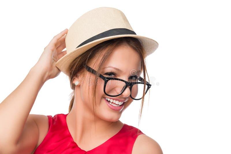 Moça alegre em um levantamento do chapéu e dos vidros fotos de stock
