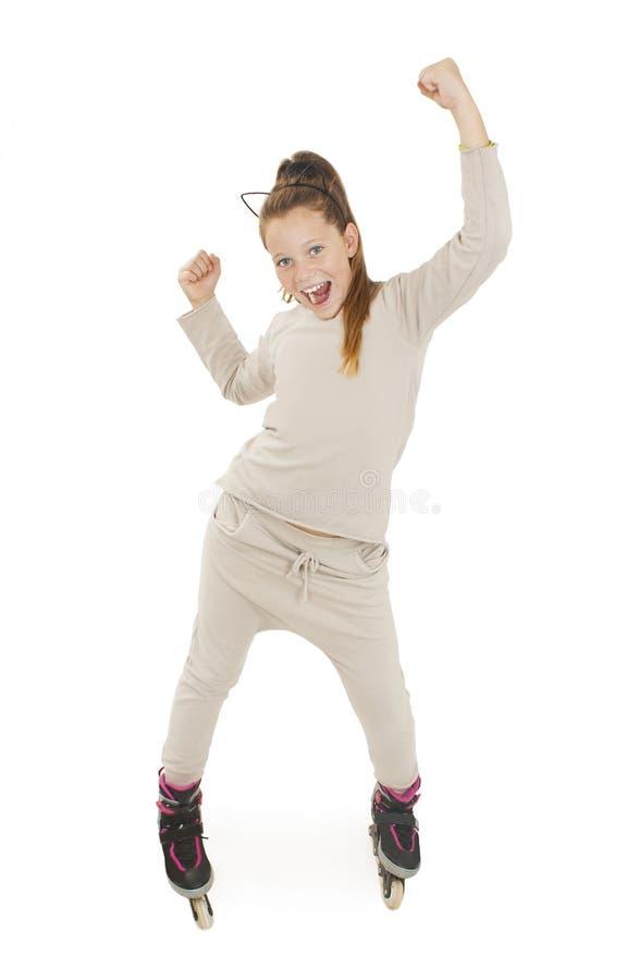 A moça bonita arma-se acima de feliz em rolos fotos de stock