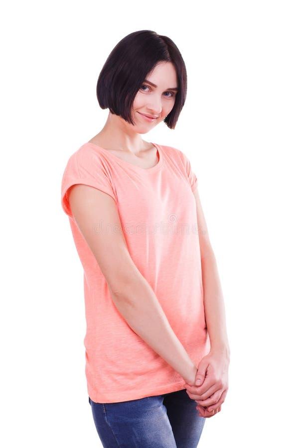 Moça bonita com o cabelo preto curto isolado em um fundo branco imagem de stock