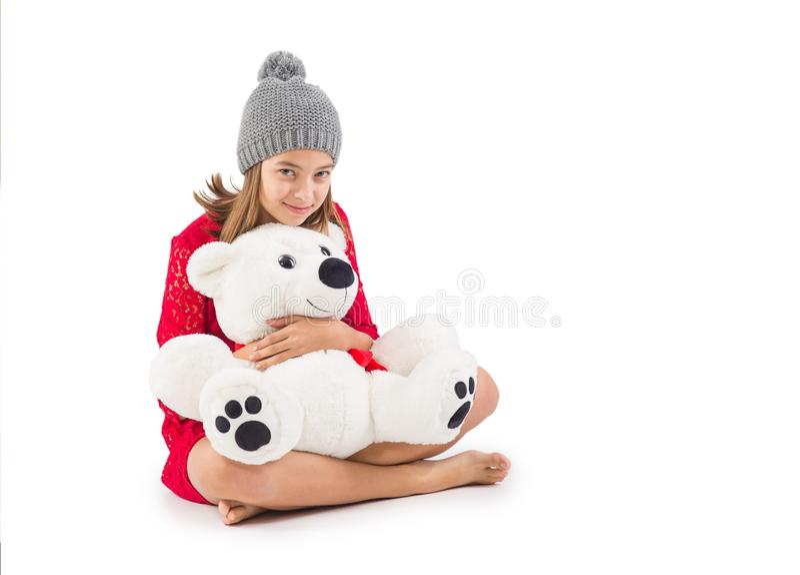 Moça bonita com o urso de peluche isolado no branco fotos de stock