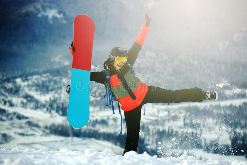 Moça bonita com um snowboard fotografia de stock royalty free