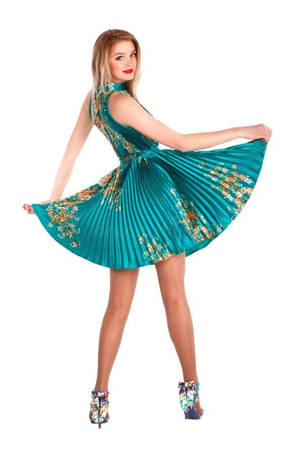 Moça bonita em uma dança verde do vestido imagens de stock