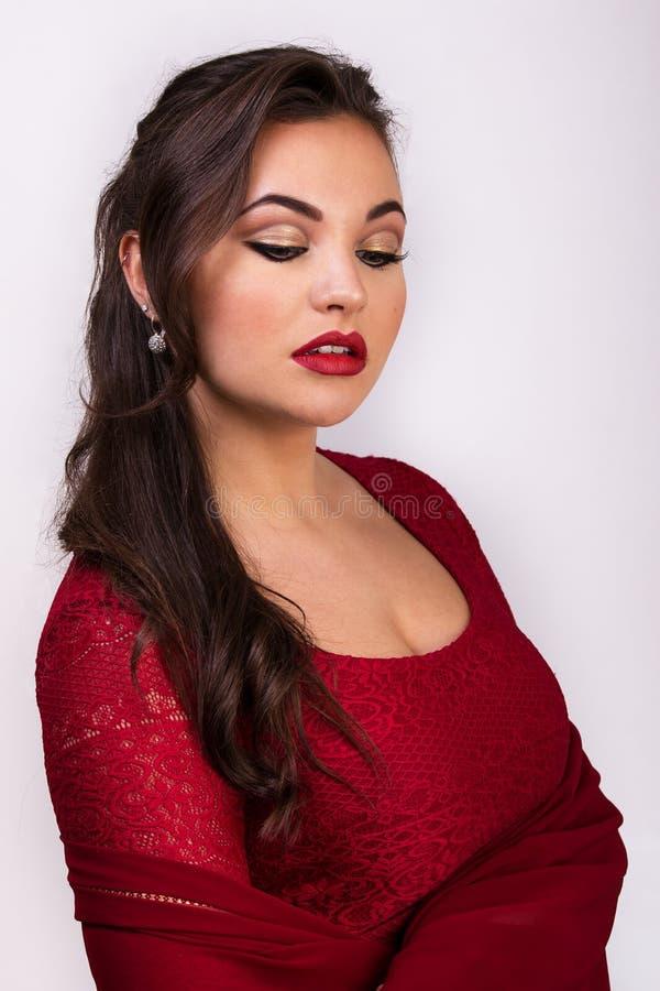 Moça bonita na roupa vermelha foto de stock royalty free