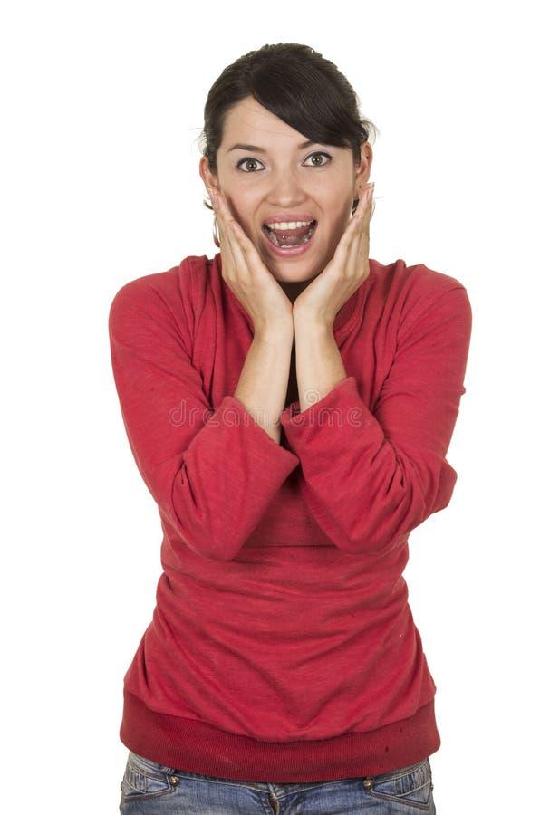 Moça bonita que veste a parte superior vermelha que levanta com foto de stock