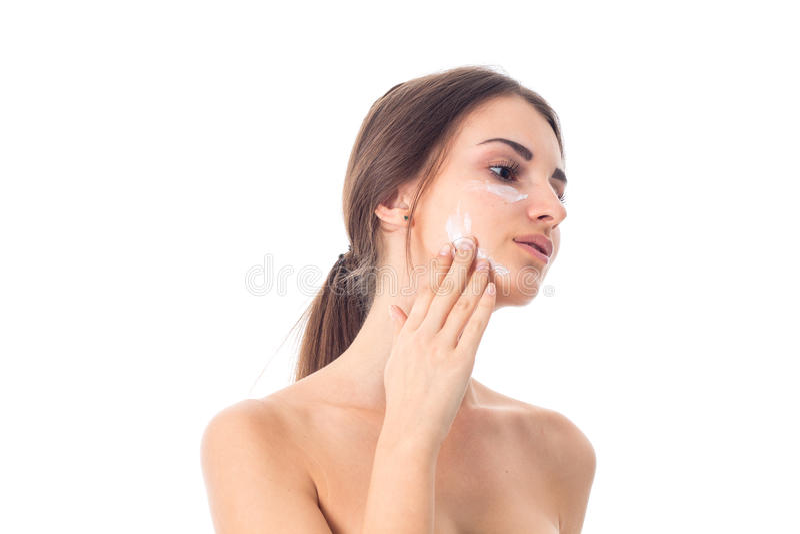 A moça ciao sua pele fotos de stock