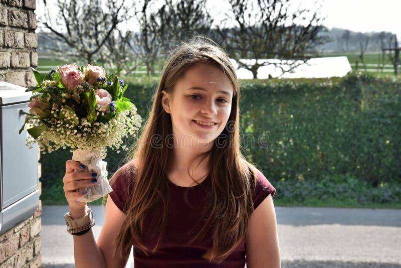 Moça com ramalhete da flor fotos de stock