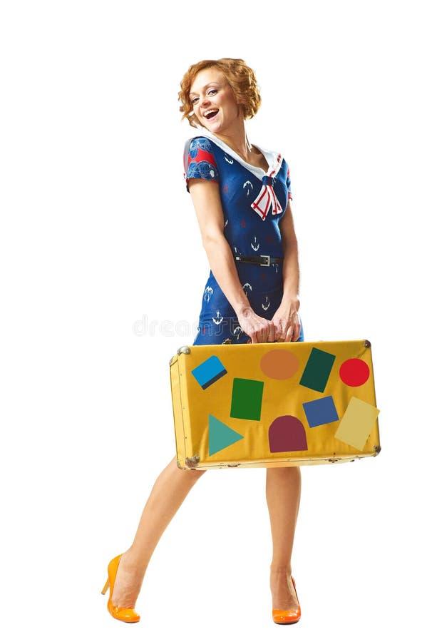 Moça da beleza com mala de viagem à disposição foto de stock royalty free