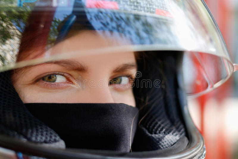 Moça em um capacete da motocicleta fotografia de stock