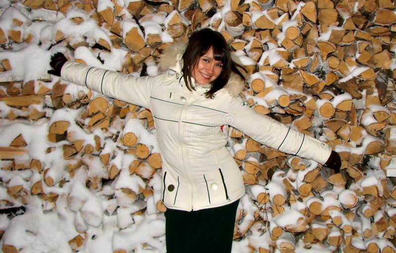 Moça em um fundo da madeira imagem de stock