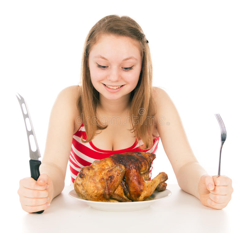 A moça em uma dieta começa a comer a galinha imagem de stock royalty free