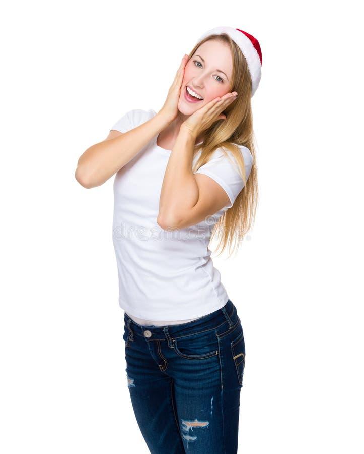 Moça feliz com chapéu do Natal imagens de stock