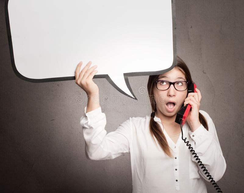 Moça que fala pelo telefone foto de stock royalty free