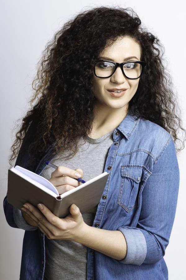 Moça que faz anotações quando ditado imagens de stock royalty free