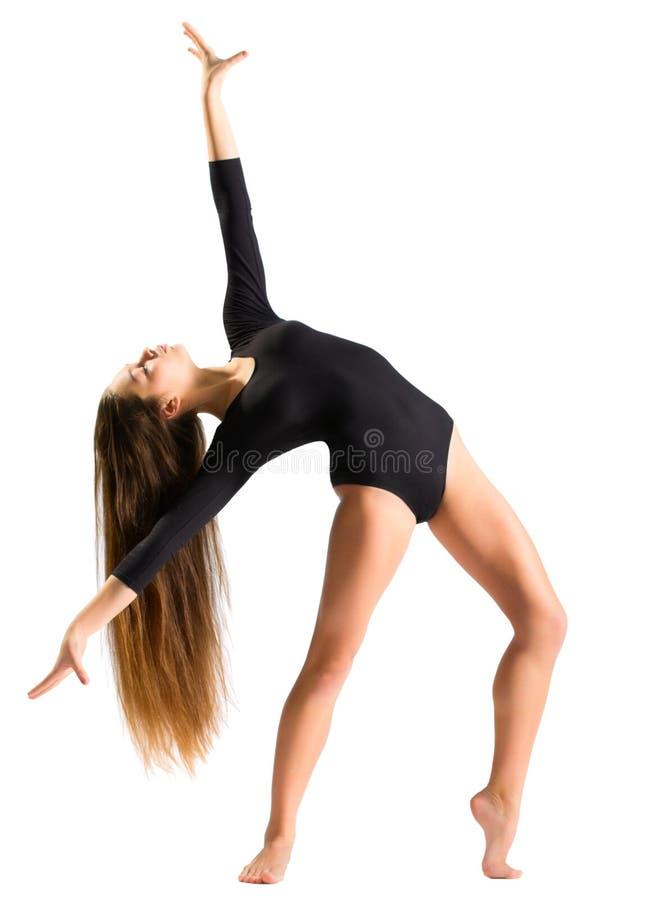 Moça que faz exercícios ginásticos imagem de stock