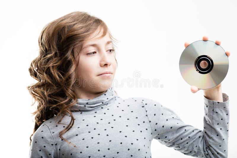 Moça que guarda o CD-ROM disc imagens de stock royalty free