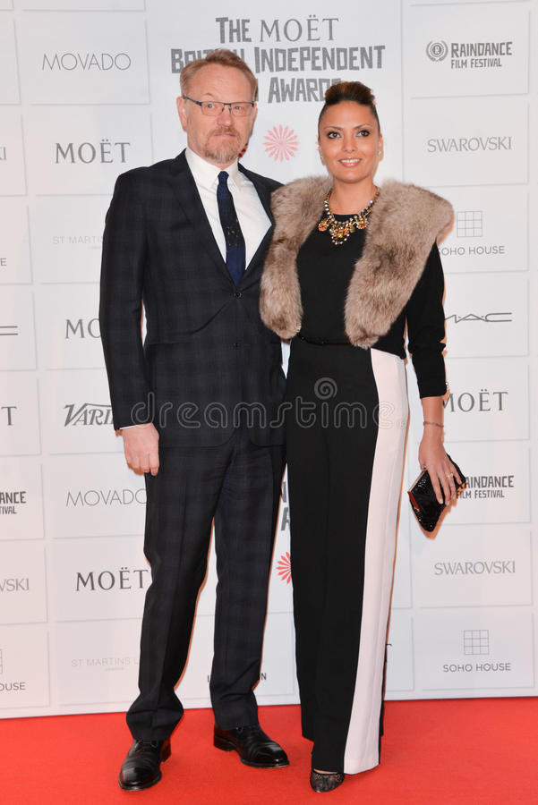 Moët British Independent Film Awards 2014. LONDON, ENGLAND - DECEMBER 07: Jared Harris and guest attends the Moet British Independent Film Awards 2014 at Old royalty free stock images
