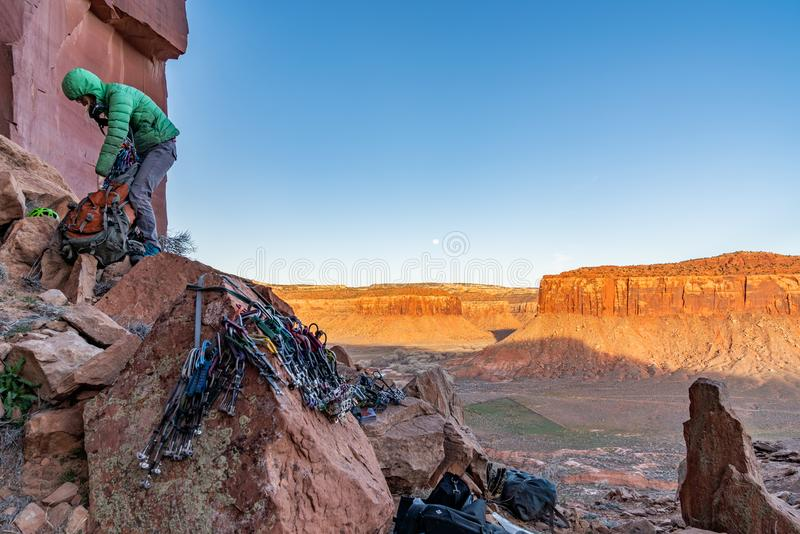 3/21/19 Moab, Utah.  Woman packing up her gear after a long day of rock climbing. stock photography