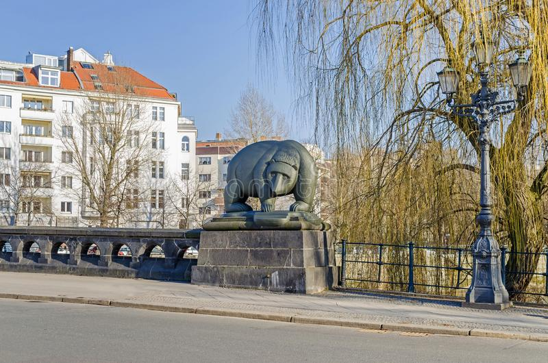 Moabiter bridge over the River Spree with the bear sculpture in a city district Moabit in Berlin, Germany royalty free stock photography