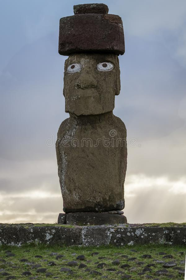 Moai on Easter Island at Ahu Tahai With Scoria Pukao Topknot and Replica Coral Eyes.  royalty free stock photos