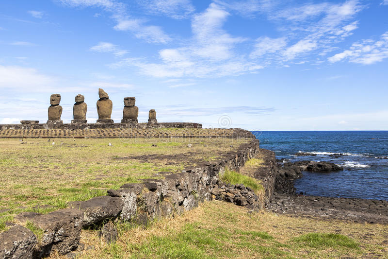MOAI IN EASTER ISLAND, CHILE. This photo was taken at 11 AM at Ahu Tahai, easter island (rapa nui), chile. Rapa Nui's mysterious moai statues stand in royalty free stock photography