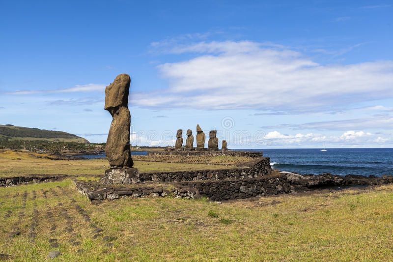 MOAI IN EASTER ISLAND, CHILE. This photo was taken at 11 AM at Ahu Tahai, easter island (rapa nui), chile. Rapa Nui's mysterious moai statues stand in stock photography