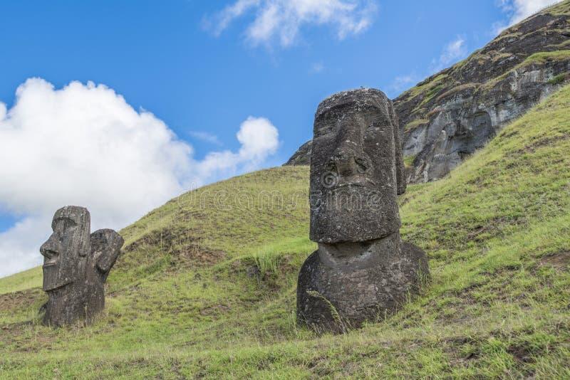 Moai guarding the Rano Raraku volcano. Path on the hill of the moais of the Rano Raraku volcano where all the moai were sculpted stock photos