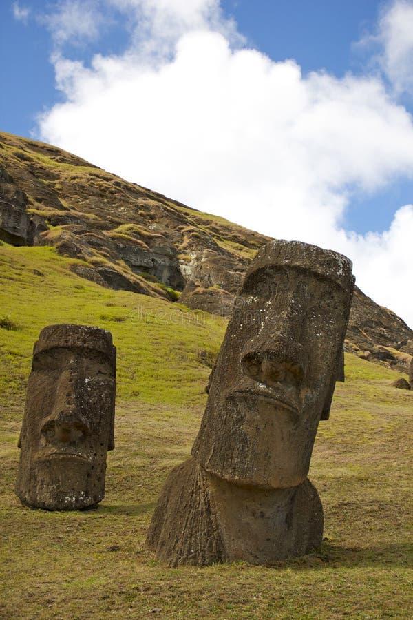 Moai on Rano Raraku, Easter Island. Half buried Moai at the Workshop or Moai Factory in Easter Island (Rapa Nui or Isla de Pascua). The workshop is located at stock image