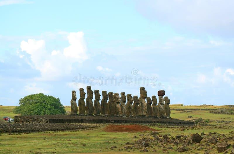 Female Traveler Photographing The Back Of Gigantic Moai