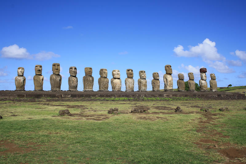 Moai statues, Easter Island, Chile. Moai statues standing to atention at Ahu Tongariki on Easter Island, Chile royalty free stock photos