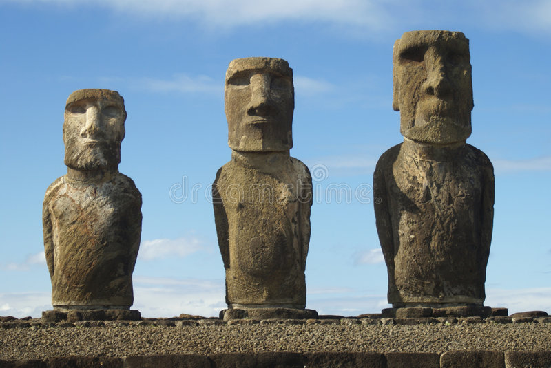 Moais. Three big moais made of volcanic rock in easter island stock image