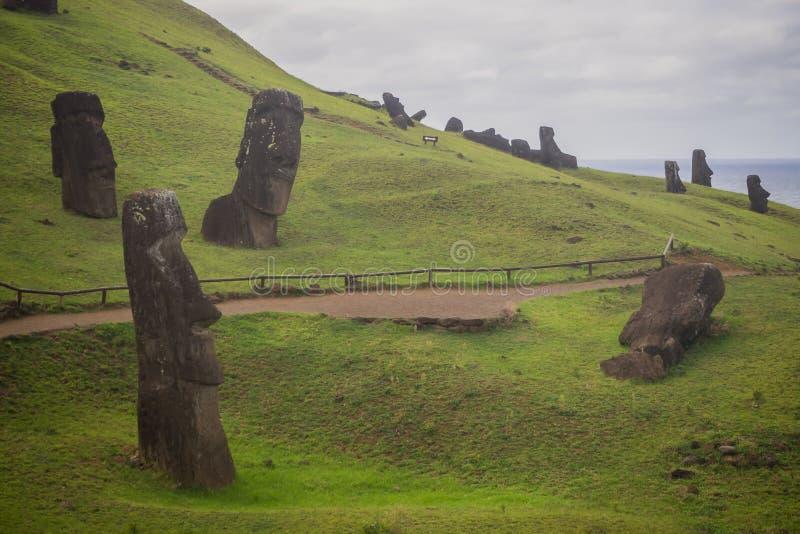 Moais statues in Rano Rarako volcano, easter Island royalty free stock photo