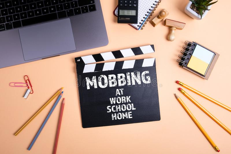 Mobbing at work, school, home. Information technology and business concept stock photos
