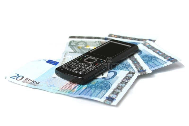 Mobiel telefoon en geld stock fotografie