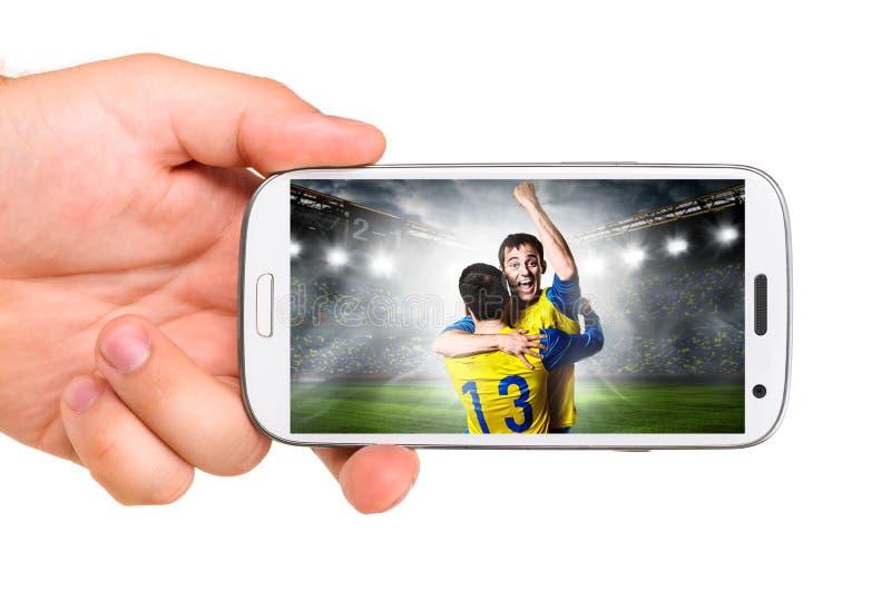 Mobiel voetbal stock fotografie