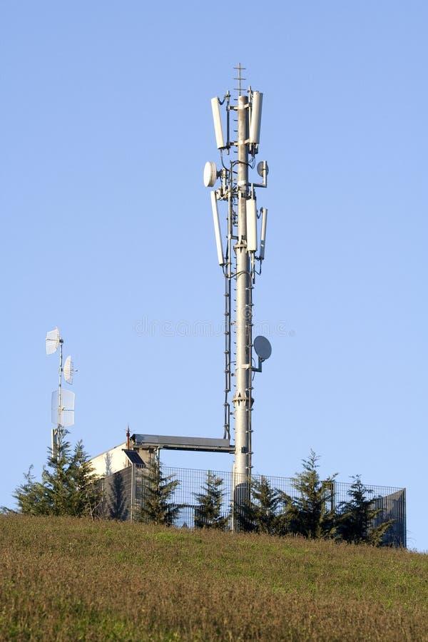 Mobiele telefonie radiotoren stock afbeelding