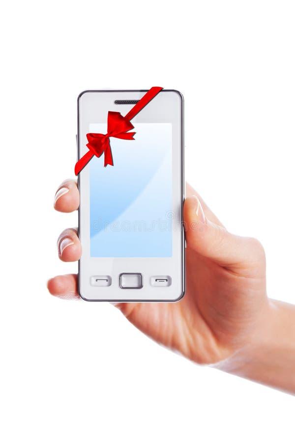 Mobiele telefoon als gift royalty-vrije stock afbeelding