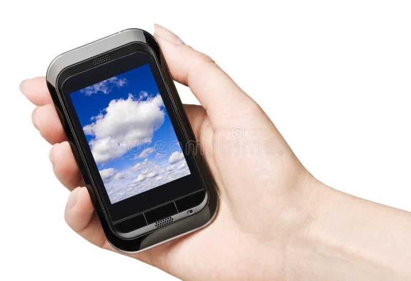 Mobiele telefoon in een hand stock foto's