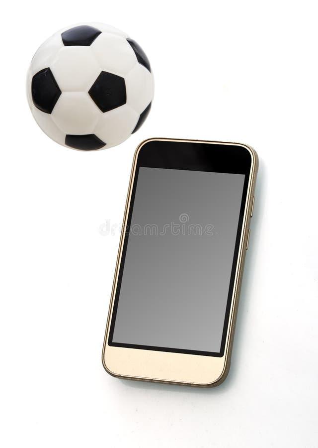 Mobiele telefoon met bal royalty-vrije stock fotografie