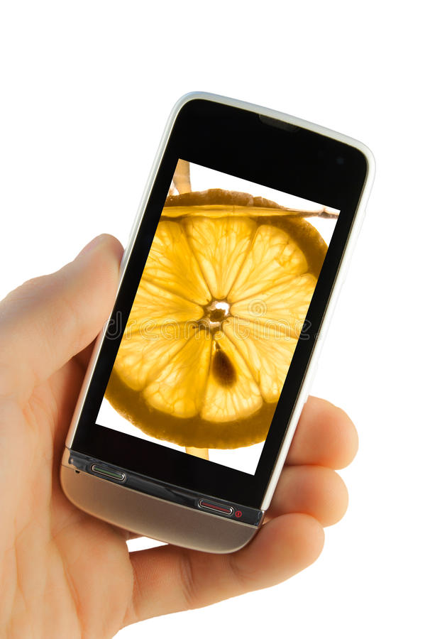 Mobiele telefoon met citroenplons stock fotografie