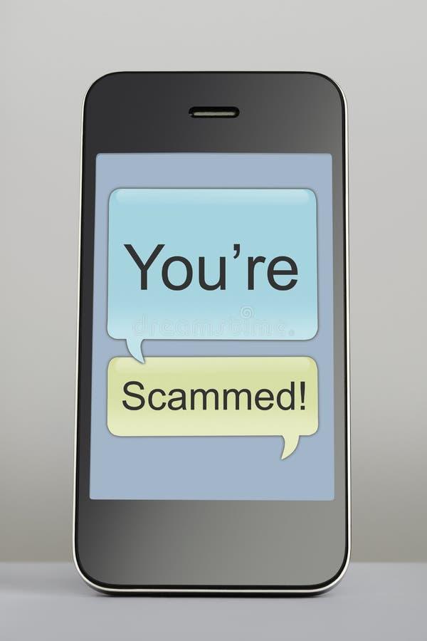 Mobiele telefoon met de toespraakbel van het zwendelbericht royalty-vrije stock afbeeldingen