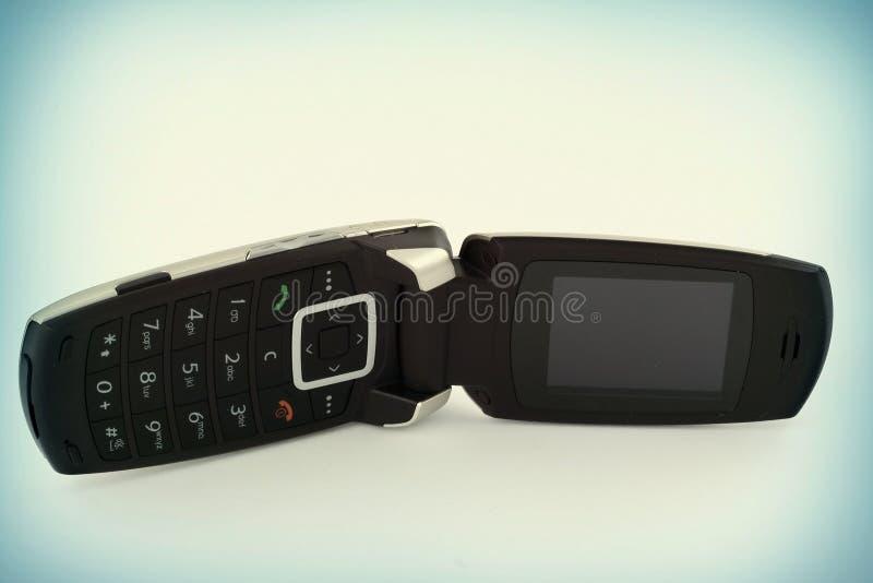 Mobiele telefoon met een klep stock afbeeldingen