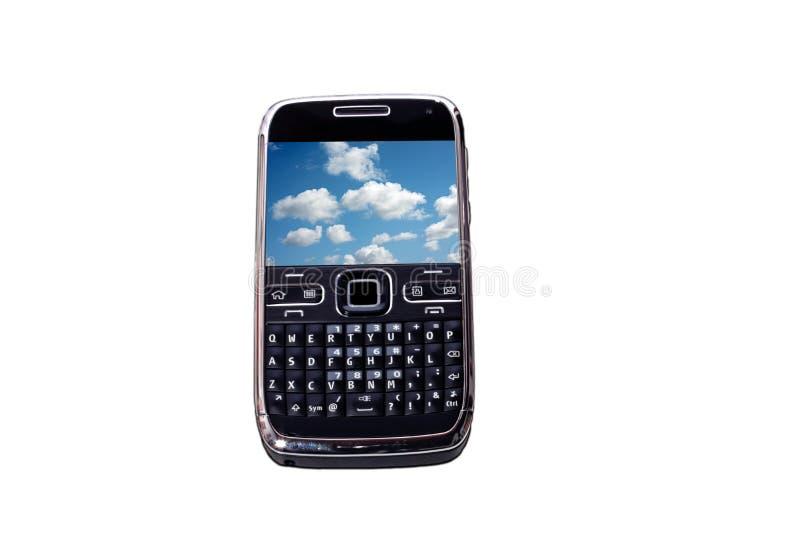 Mobiele telefoon met hemelbehang stock fotografie