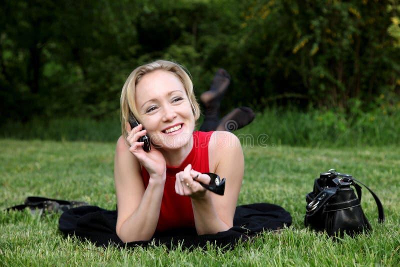 MOBIL电话妇女 图库摄影