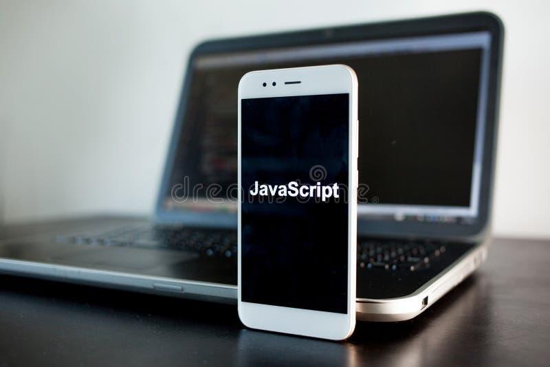 Mobil applikationutveckling, programmera språk för Javascript för mobil utveckling arkivbild