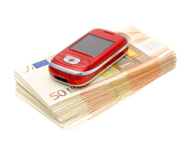 Mobil-Telefon u. Geld stockfotografie