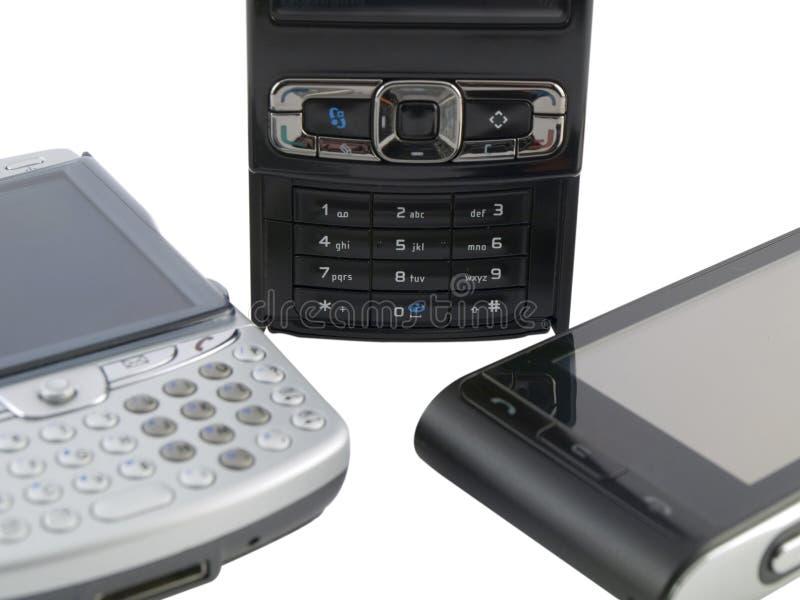 mobila moderna telefoner flera staplar white royaltyfria foton
