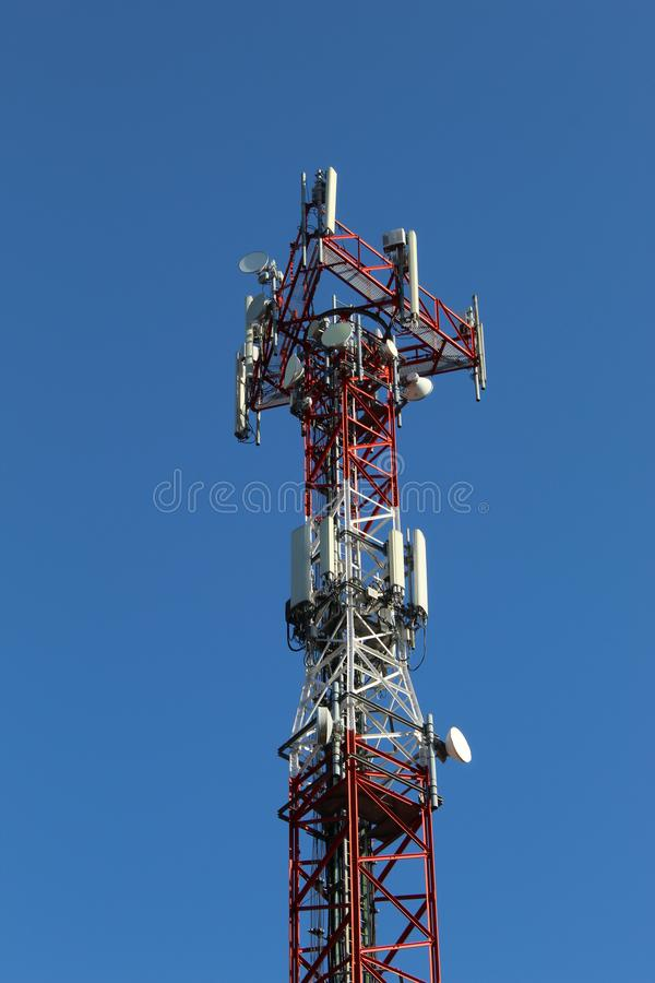 Mobile antenna in middle of forest stock images