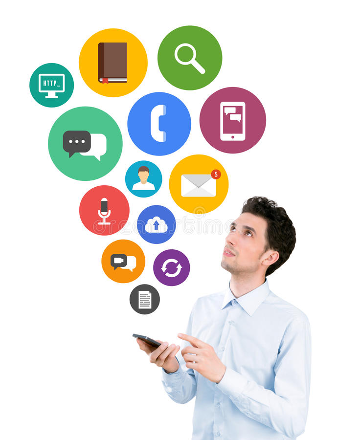 Mobile apps concept. Handsome young man holding smartphone and looking on collection of colorful mobile application icons on communication and mobile connection